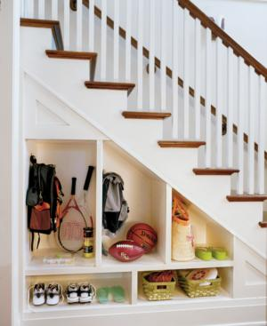 Clever under staircase storage space home designs project for Area above kitchen cabinets called