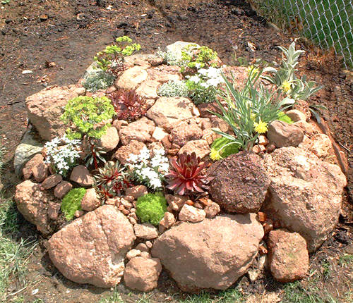 Slope garden design path home designs project for Simple rock garden designs